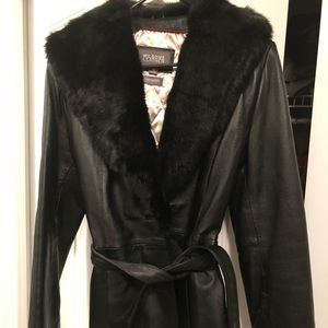Women's belted leather jacked with fur trim.
